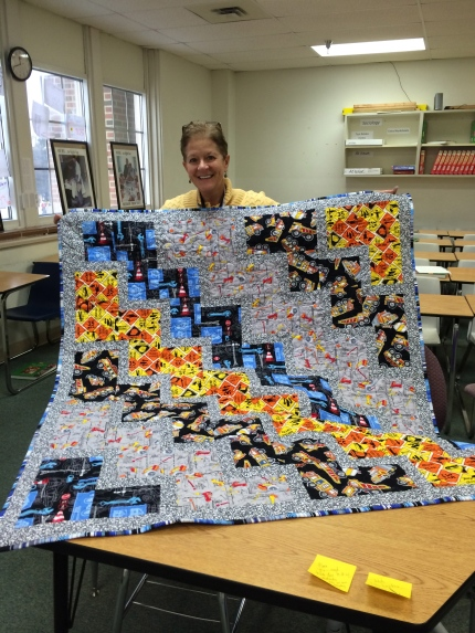 Cindy holding Lincoln's quilt